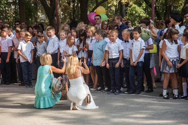 Odessa, Ukraine - May 31,2018: Children`s musical group sing and. Dance on stage during graduation concert of elementary school. Children play. Emotional stock photo