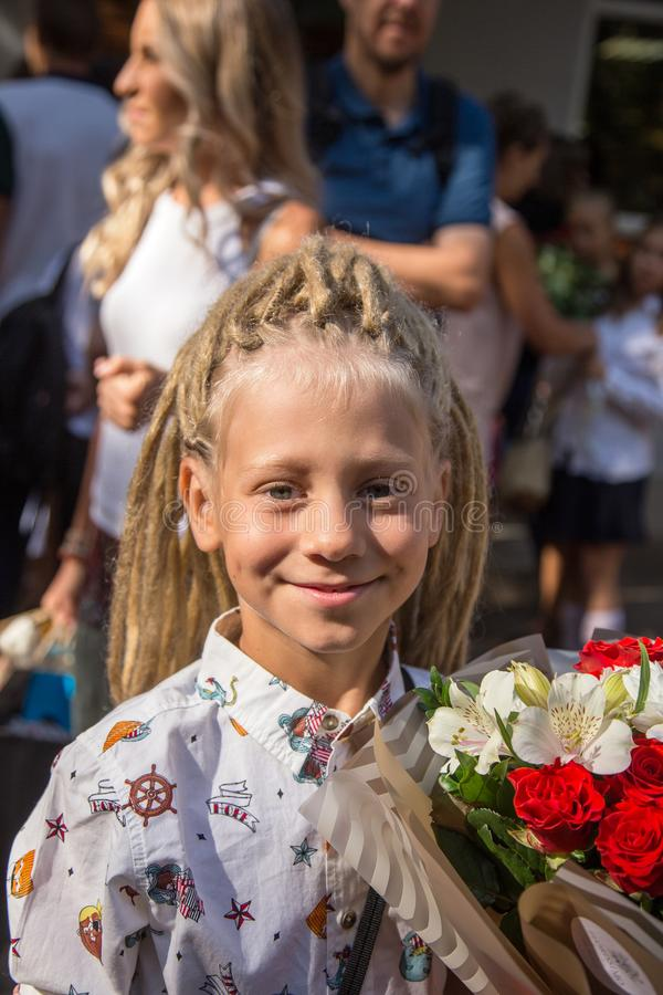 Odessa, Ukraine - May 31,2018: Children`s musical group sing and. Dance on stage during graduation concert of elementary school. Children play. Emotional royalty free stock photography