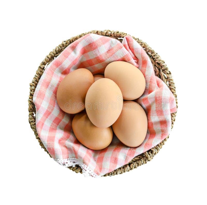 Odgórnego widoku świeży jajko w koszu odizolowywającym na bielu fotografia royalty free