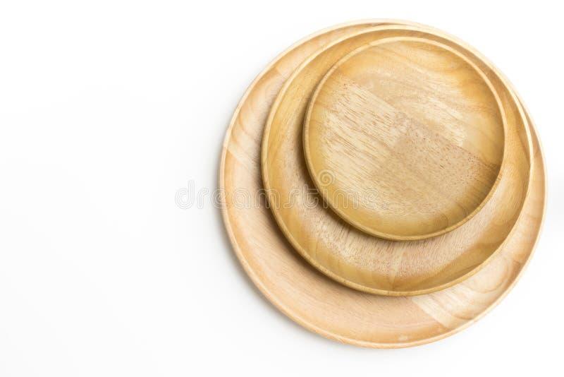 Odgórnego widoku drewniani talerze lub tace odizolowywali białego tło obrazy royalty free