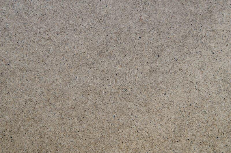 Odgórnego widoku hardboard frontowej strony sklejkowa materialna tekstura robić od naciskającego trociny zdjęcia stock