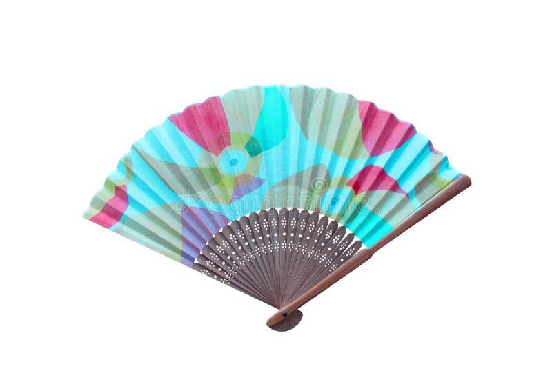 Odgórnego widoku ręki stubarwny drewniany fan z łachmanem odizolowywającym na białym tle zdjęcia royalty free