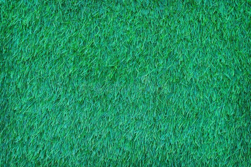 Odgórnego widoku sztuczna zielona trawa deseniuje tekstura abstrakt dla tła zdjęcie stock