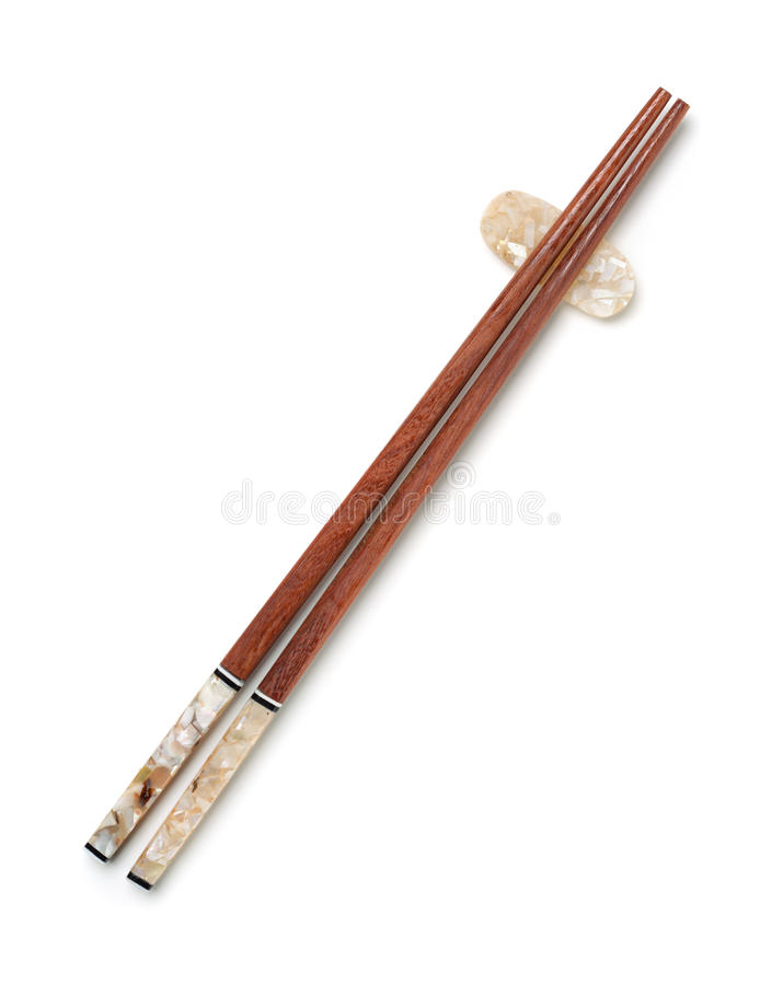 Odgórny widok drewniani chopsticks na chopstick odpoczynku zdjęcia stock