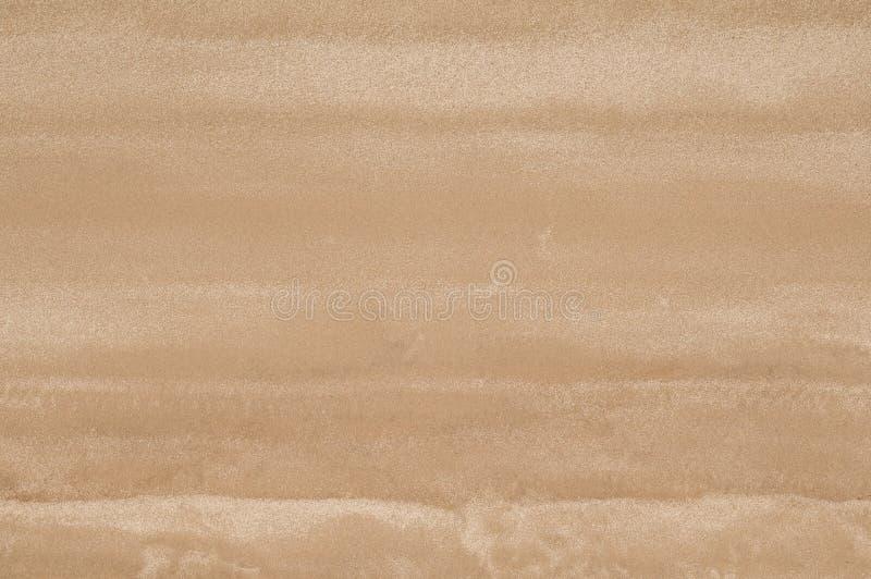 Odgórny widok piaskowata plaża Tło z kopii astronautyczną i widoczną piasek teksturą fotografia stock