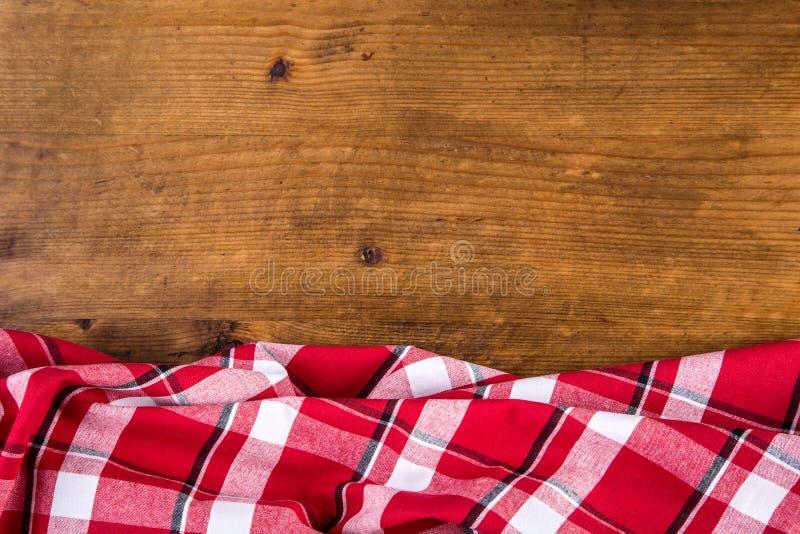 Download Odgórny Widok W Kratkę Kuchenni Ręczniki Na Drewnianym Stole Obraz Stock - Obraz złożonej z menu, pielucha: 57660709