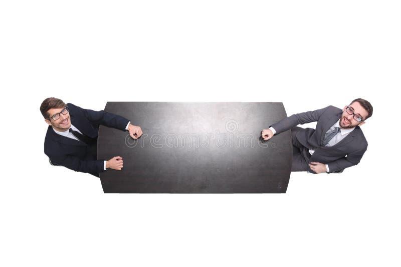 Odg?rny widok dwa ludzie biznesu dyskutuje coś przy spotkaniem fotografia royalty free
