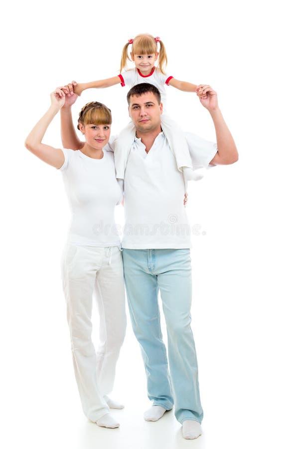 Odizolowywająca na biel szczęśliwa młoda rodzina obrazy royalty free