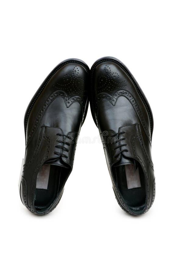Odizolowywający czarny buty zdjęcia stock