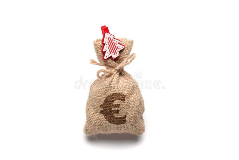 Odizolowywający na białej torbie z pieniądze, euro znak, nowy rok i choinka, zdjęcie stock