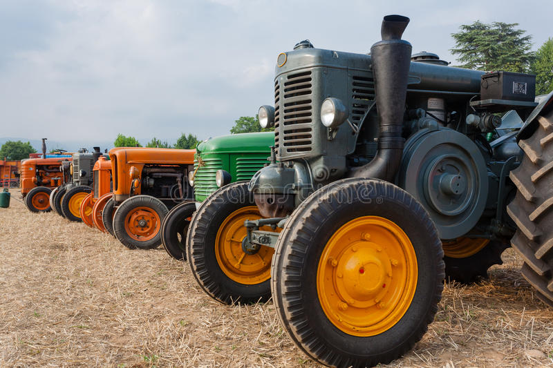 Odl tractors. Seven old tractors in perspective, farming, agriculture stock image