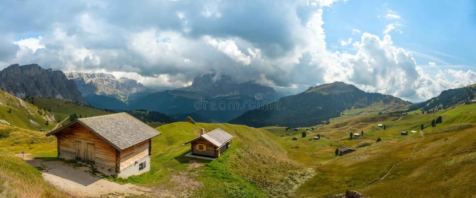 Odle Puez mountain and wooden chalets in Dolomites, Trentino Alto Adige, Italy stock photos