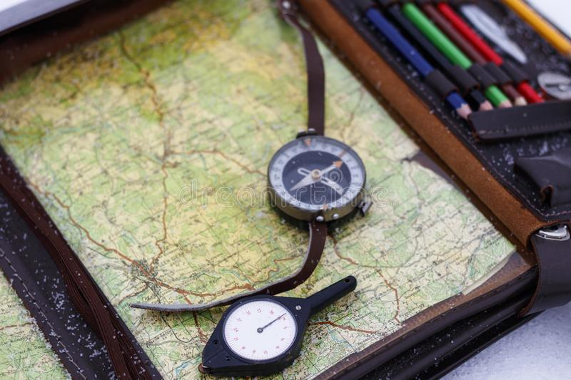 . odometer in focus. military commander& x27;s bag with a compass. map for the route. there is toning. Odometer in . military commander& x27;s bag with a compass royalty free stock photos