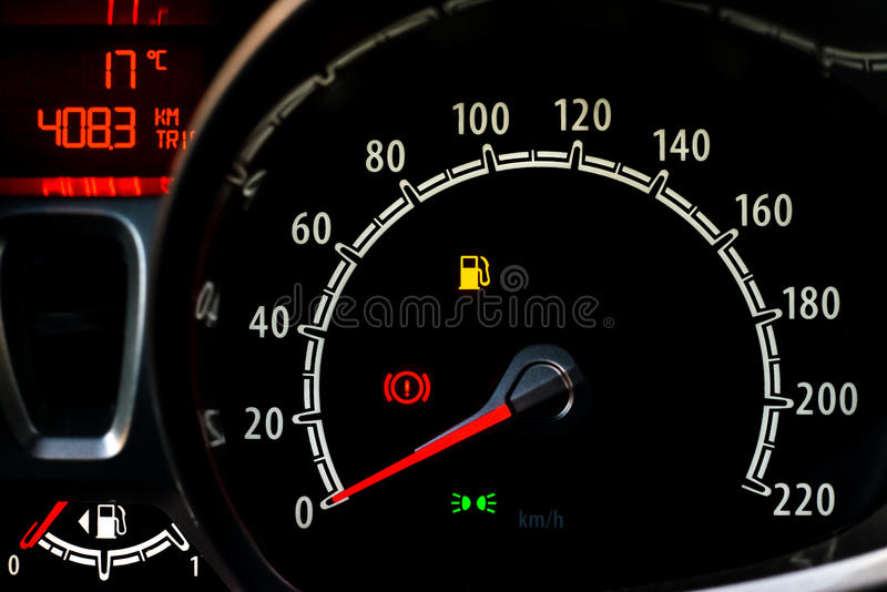 Odometer. Red and white Odometer in a car console royalty free stock photography