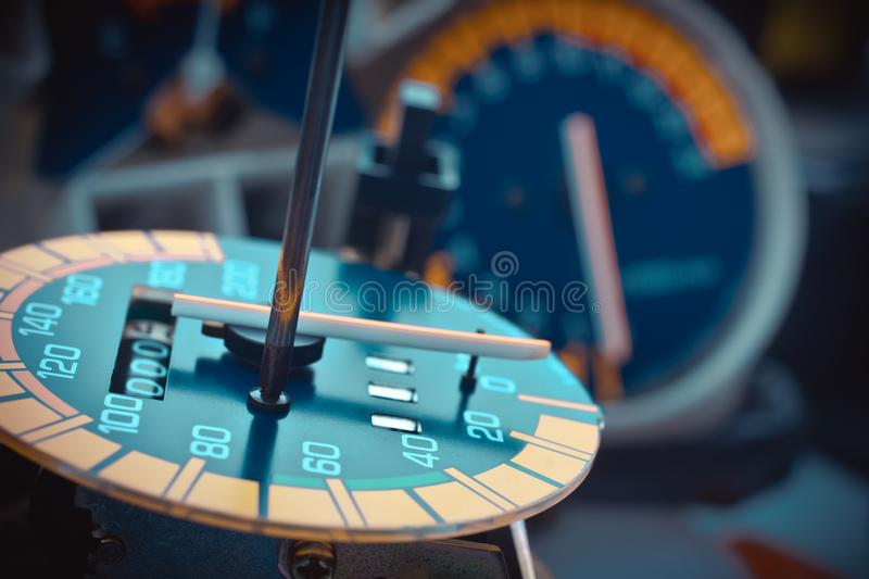 """Odometer Reprogramming """"car clocking"""" hand of technician Mod. Ify and reset number The speedometer stock photos"""
