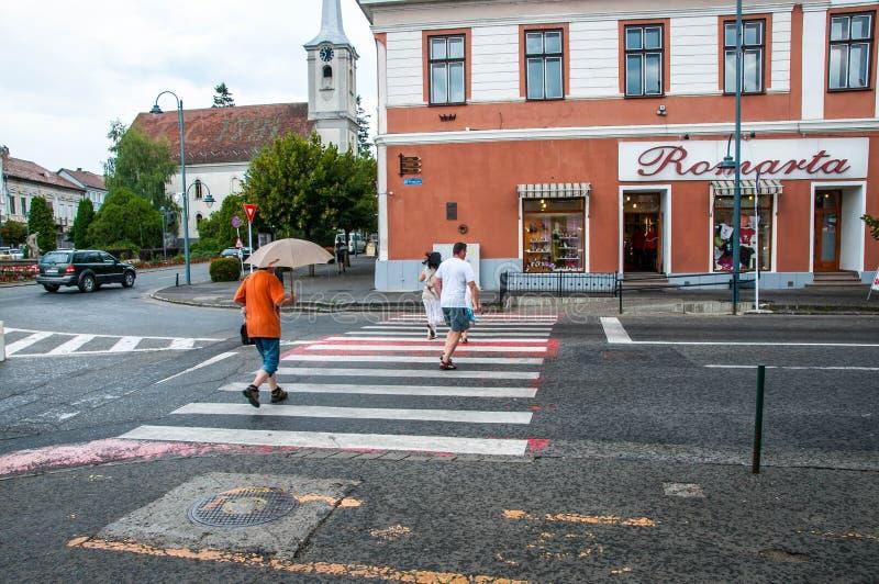 Runing people on pedestrian crossing in rain. stock photo