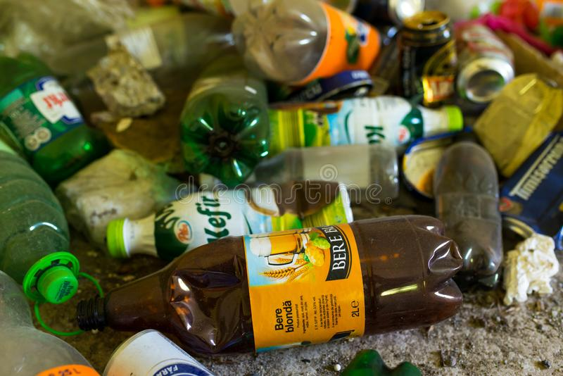 Empty beer and soda plastic bottles on abandoned house floor close up shot. Odorheiu Secuiesc, Romania- 16 June 2019: Empty beer and soda plastic bottles on stock images