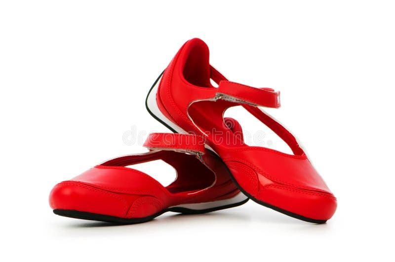 odosobneni buty bawją się biel obraz stock