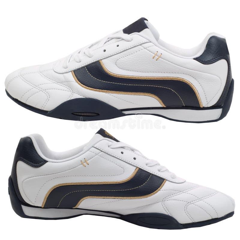 odosobneni buty bawją się biel zdjęcia stock