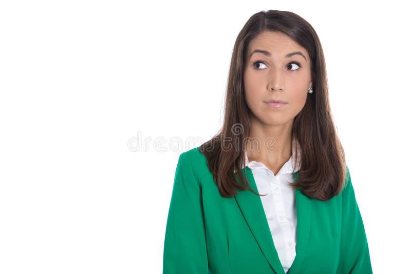 Odosobniona biznesowa kobieta w zielony patrzeje wątpliwy z ukosa te zdjęcia stock