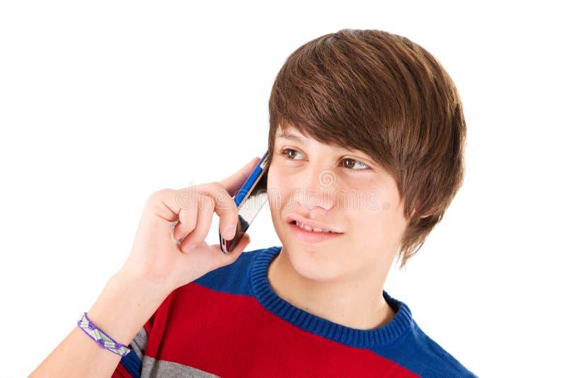 Odosobniona chłopiec ciągle na telefonie obrazy royalty free