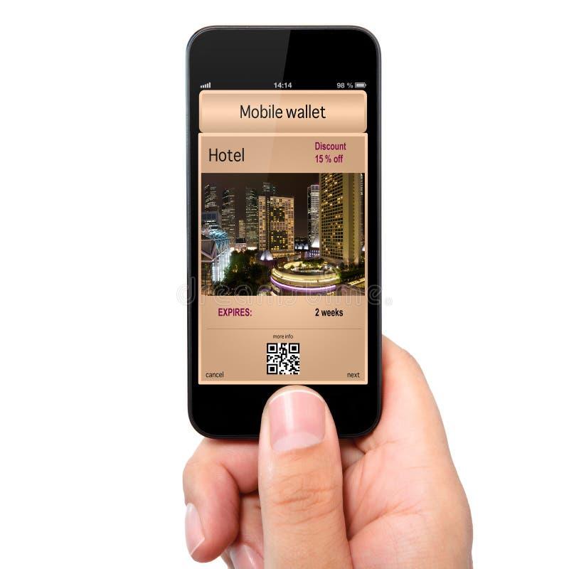 Odosobniona mężczyzna ręka trzyma telefon z mobilnym pai i portflem obrazy stock