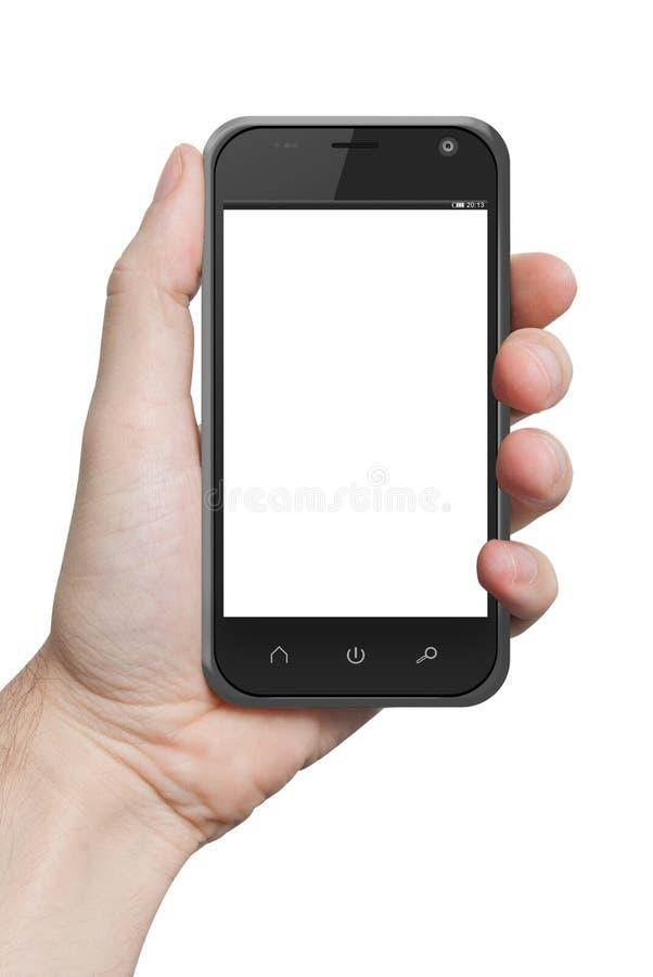 Odosobniona męska ręka trzyma telefon pastylki dotyka komputeru gadge fotografia royalty free