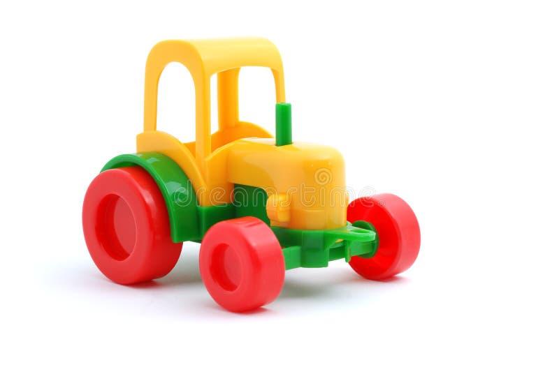 odosobniony mały zabawkarski ciągnikowy biel obraz stock