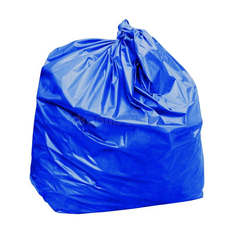 Odpady, błękitny torba na śmiecie klingeryt z pojęciem kolor błękitni torba na śmiecie jest ogólnym odpady odizolowywającym na bi obraz royalty free