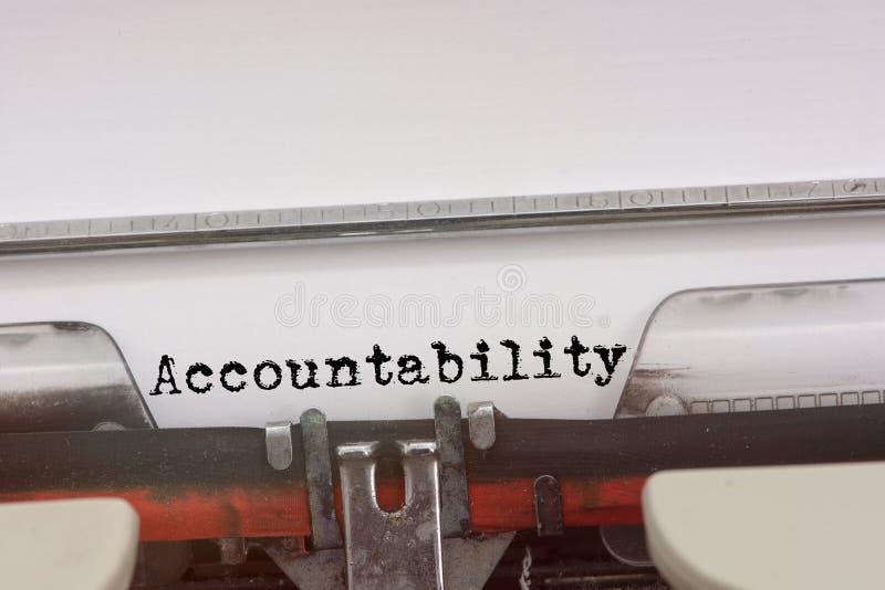 Odpowiedzialności słowo pisać na maszynie na rocznika maszyna do pisania fotografia royalty free