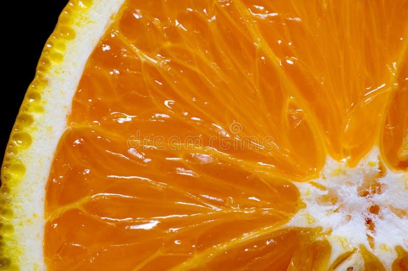 odseparowana pomarańcze plastry czerni obraz royalty free