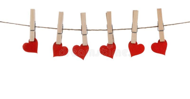 Odzieżowi czopy i serca na arkanie zdjęcia stock
