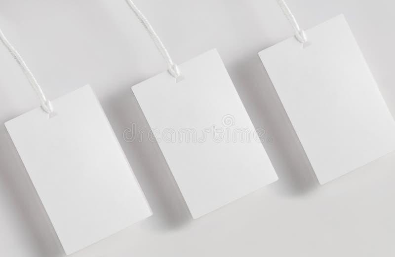 Odziewa etykietki etykietki pustego białego mockup zdjęcia stock