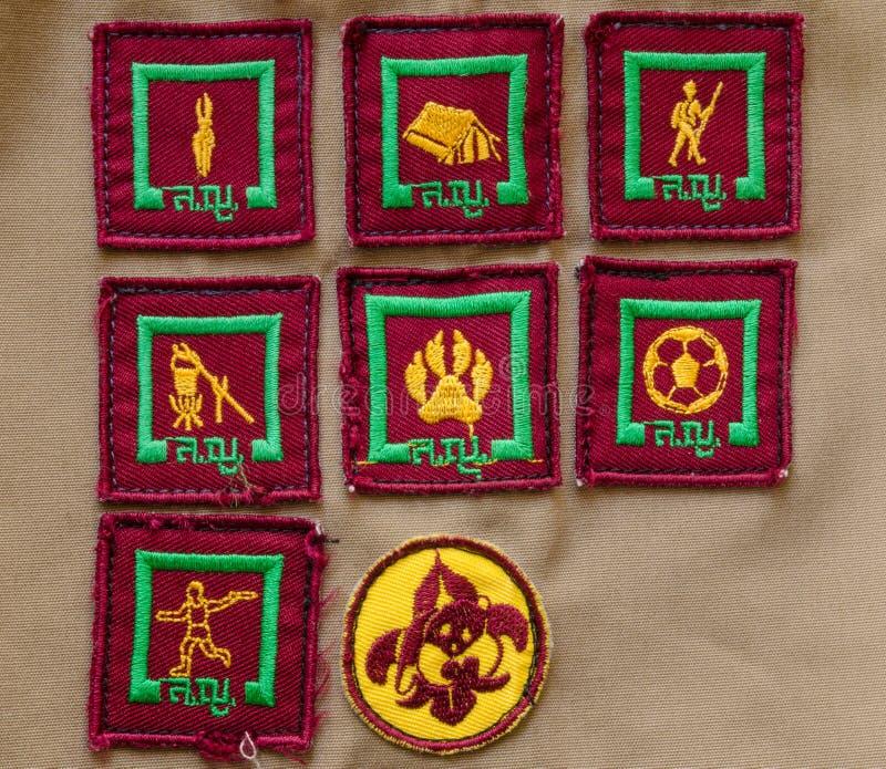 Odznaki na harcerza mundurze zdjęcia royalty free