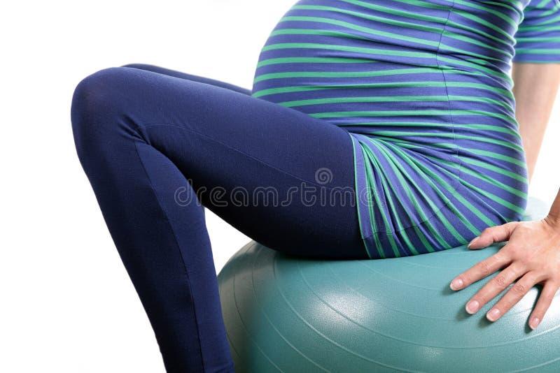 Oefening in zwangerschap stock afbeelding