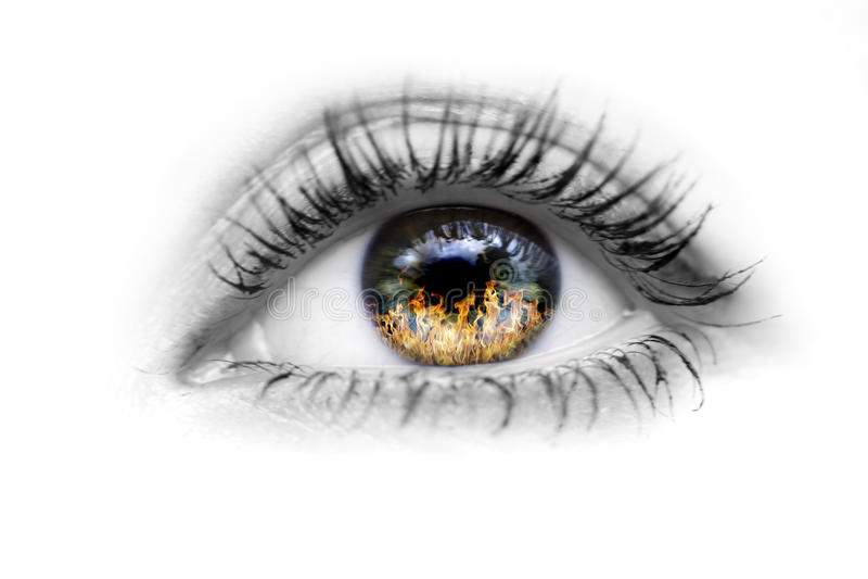 Oeil avec l'incendie dans les yeux images libres de droits