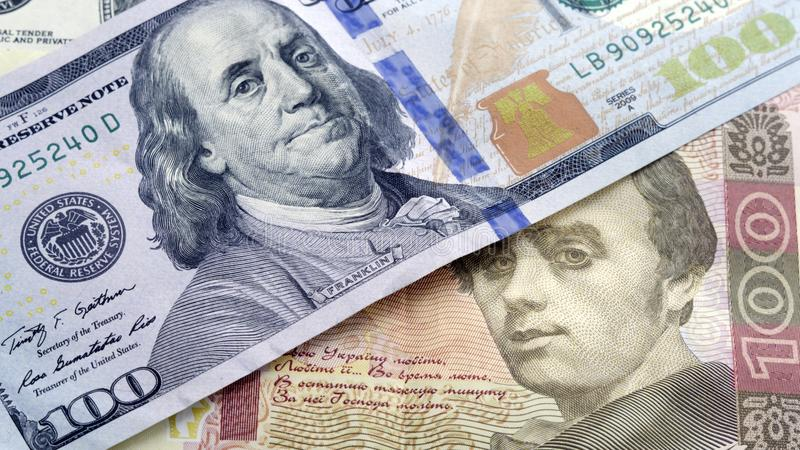 Oekraïense contant geldhryvnia en dollars de V.S. Muntwisselkoers concep stock foto
