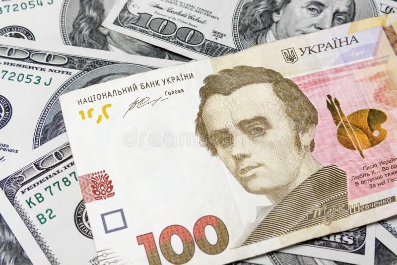 Oekraïense hryvnia, dollar, geldclose-up Bankbiljetten het concept royalty-vrije stock afbeelding