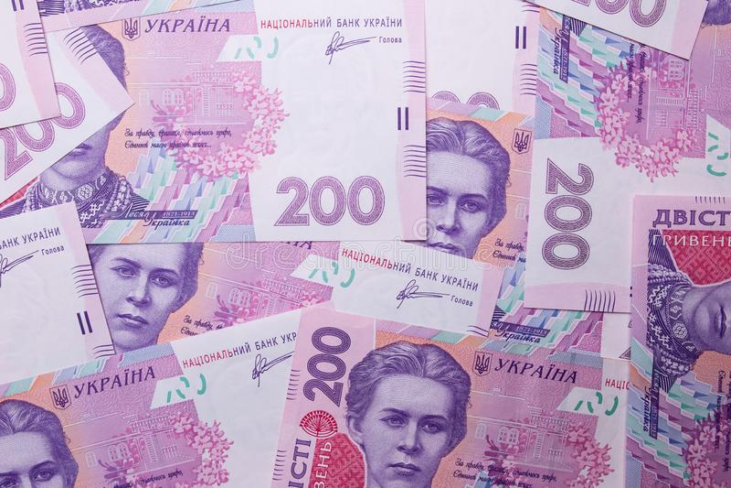 Oekra?ens geld Hryvniadocument rekening Nota's in benamingen van twee honderd hryvna uah cash Achtergrond textuur stock afbeelding