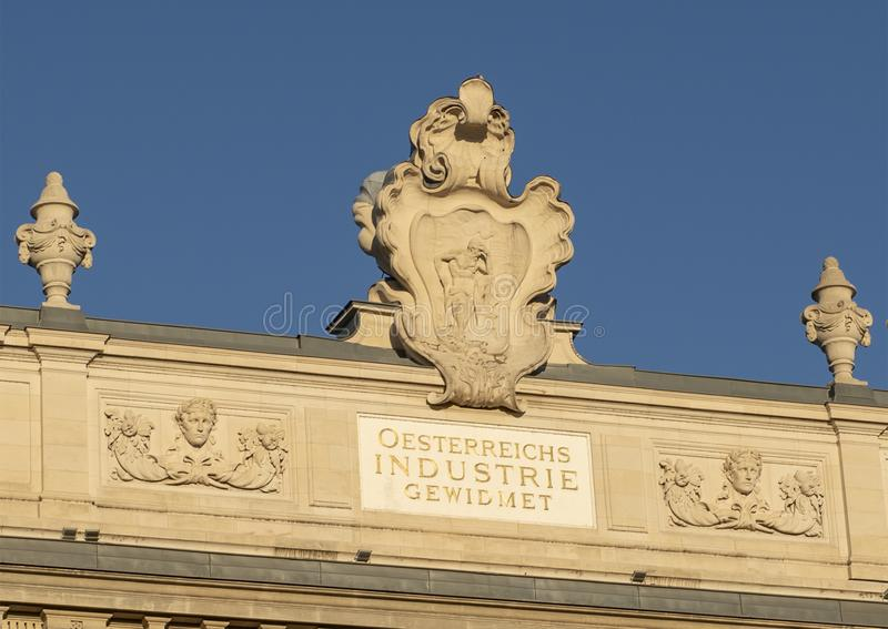 Oesterreichs industrie gewidmet sculpture and sign, Wien, Austria. Pictured is an inscription that reads `OSTERREICHS INDUSTRIE GEWIDMET`, English translation ` stock photo