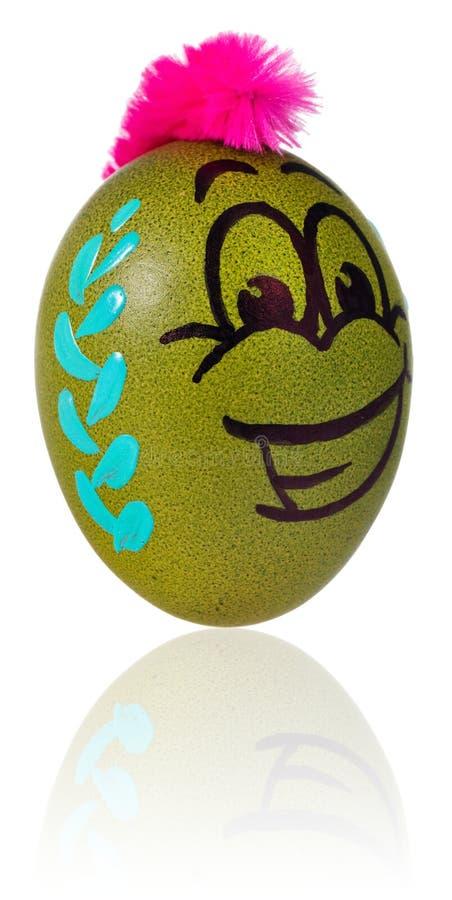 Oeuf de pâques, peint dans le visage de sourire de bande dessinée du type Décoré par exemple images stock