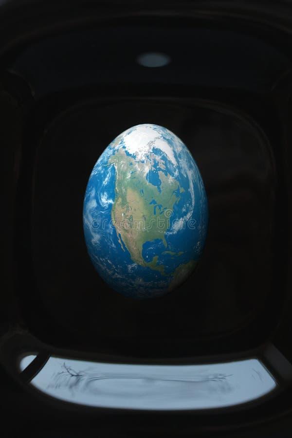 Oeuf de pâques sous forme de terre de planète Créatif sur le sujet de la coloration images libres de droits