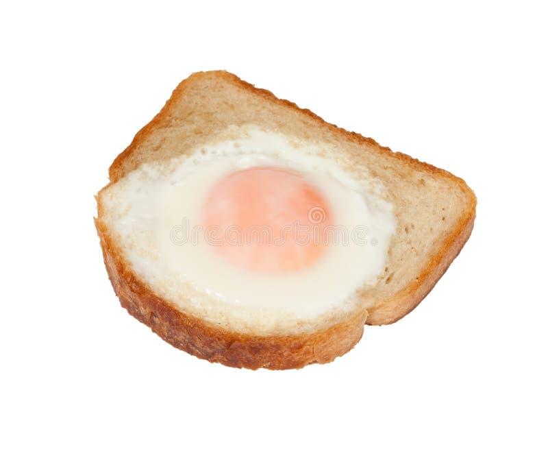 Oeuf sur le plat dans le pain grillé blanc photographie stock