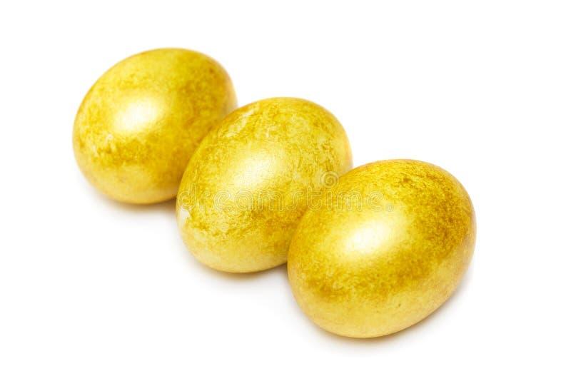 Oeufs d'or heureux de Pâques images stock
