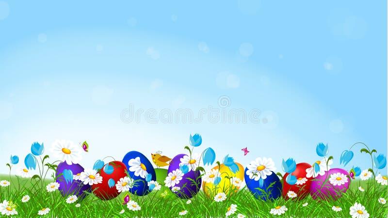 Oeufs de pâques colorés et l fleurs de ressort photographie stock libre de droits