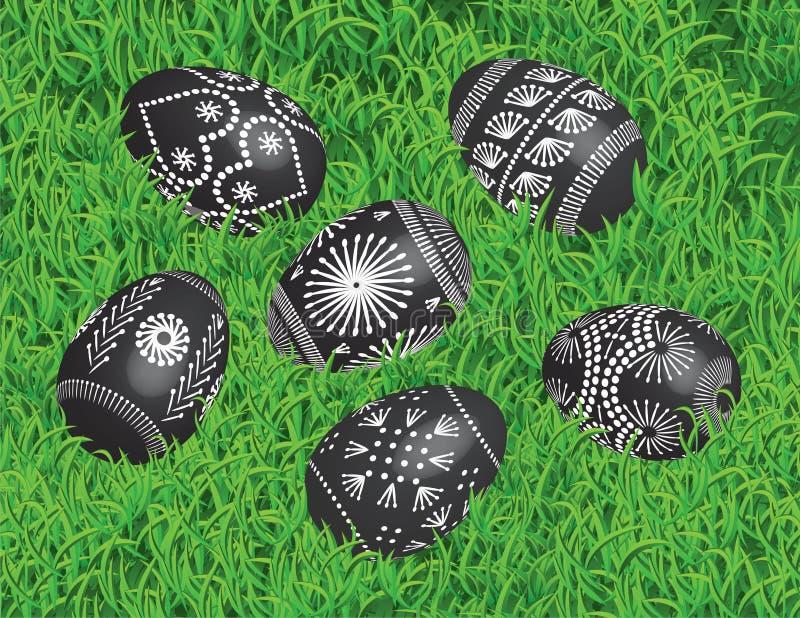 9. oeufs de pâques noirs décorés sur le lit de l'herbe photo stock
