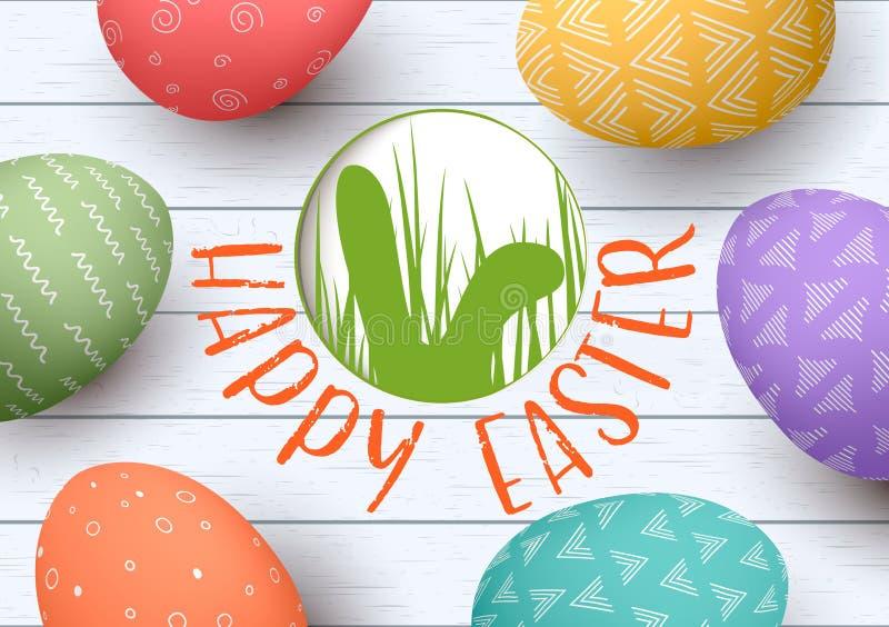 Oeufs de pâques ornementés de fête sur le fond en bois blanc Joyeuses Pâques insigne avec la silhouette d'oreilles de lapins illustration stock