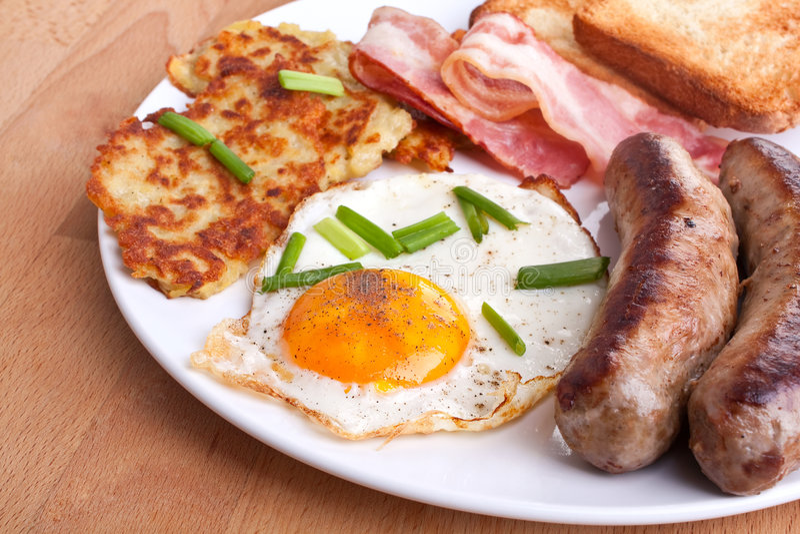 Oeufs et déjeuner de lard images stock
