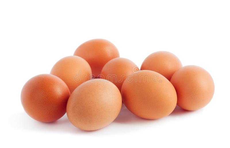 Oeufs jaunes frais de poulet sur le fond blanc photo stock