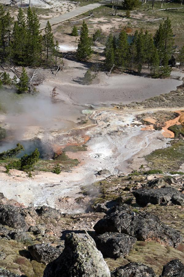 Off the Beaten Path. Typical geothermal volcanic activity at Yellowstone National Park in Wyoming including mud and paint pots as well as hot springs...a stock photo